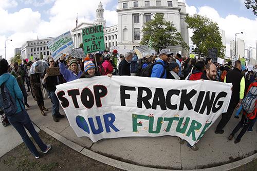 <div class='meta'><div class='origin-logo' data-origin='AP'></div><span class='caption-text' data-credit='AP Photo/David Zalubowski'>Protesters against fracking during a march for science Saturday, April 22, 2017, in Denver.</span></div>