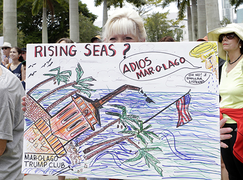<div class='meta'><div class='origin-logo' data-origin='AP'></div><span class='caption-text' data-credit='AP Photo/Alan Diaz'>A marcher holds a sign during a March for Science on Earth Day, Saturday, April 22, 2017, in Miami.</span></div>