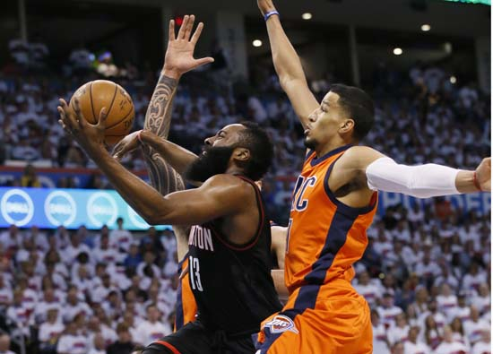<div class='meta'><div class='origin-logo' data-origin='AP'></div><span class='caption-text' data-credit='AP'>Houston Rockets guard James Harden, center, goes up for a shot between Oklahoma City Thunder center Steven Adams, rear, and forward Andre Roberson, right. (AP Photo/Sue Ogrocki)</span></div>