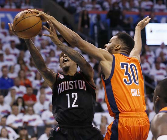 <div class='meta'><div class='origin-logo' data-origin='AP'></div><span class='caption-text' data-credit='AP'>Oklahoma City Thunder guard Norris Cole (30) blocks the shot of Houston Rockets guard Lou Williams (12) in the second quarter of Game 4. (AP Photo/Sue Ogrocki)</span></div>