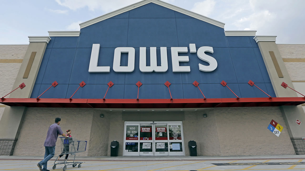 In this June 29, 2016, file photo, customers walk toward a Lowe's store in Hialeah, Fla. Lowe's reports financial results Wednesday, Nov. 16. (AP Photo/Alan Diaz, File)