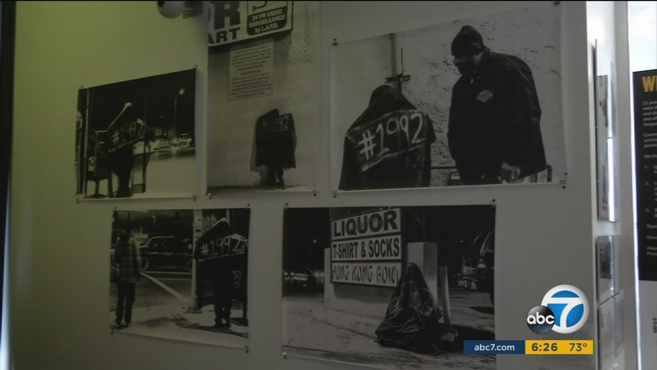 Photos taken during the 1992 Los Angeles riots are shown as part of the 'Re-Imagine Justice' exhibit at the Community Coalition in South L.A.