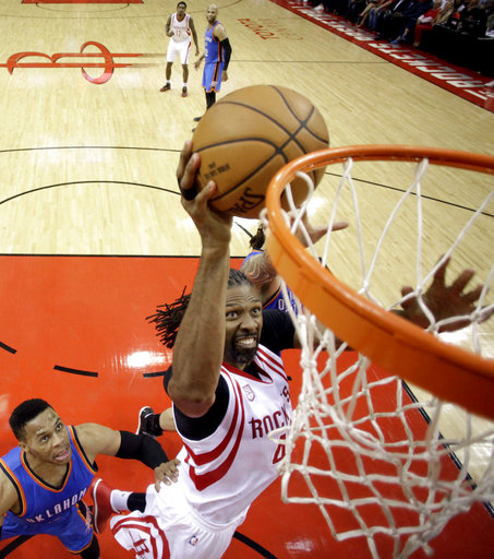 <div class='meta'><div class='origin-logo' data-origin='AP'></div><span class='caption-text' data-credit='AP'>Houston Rockets' Nene, right, goes up for a shot as Oklahoma City Thunder's Russell Westbrook, left, and another Thunder player defend (AP Photo/David J. Phillip)</span></div>