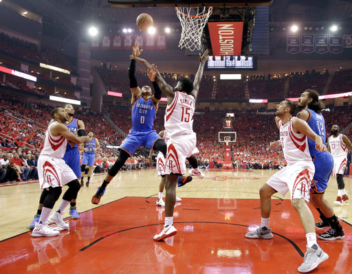 <div class='meta'><div class='origin-logo' data-origin='AP'></div><span class='caption-text' data-credit='AP'>Oklahoma City Thunder's Russell Westbrook (0) shoots as Houston Rockets' Clint Capela (15) defends during the first half in Game 5  (AP Photo/David J. Phillip)</span></div>