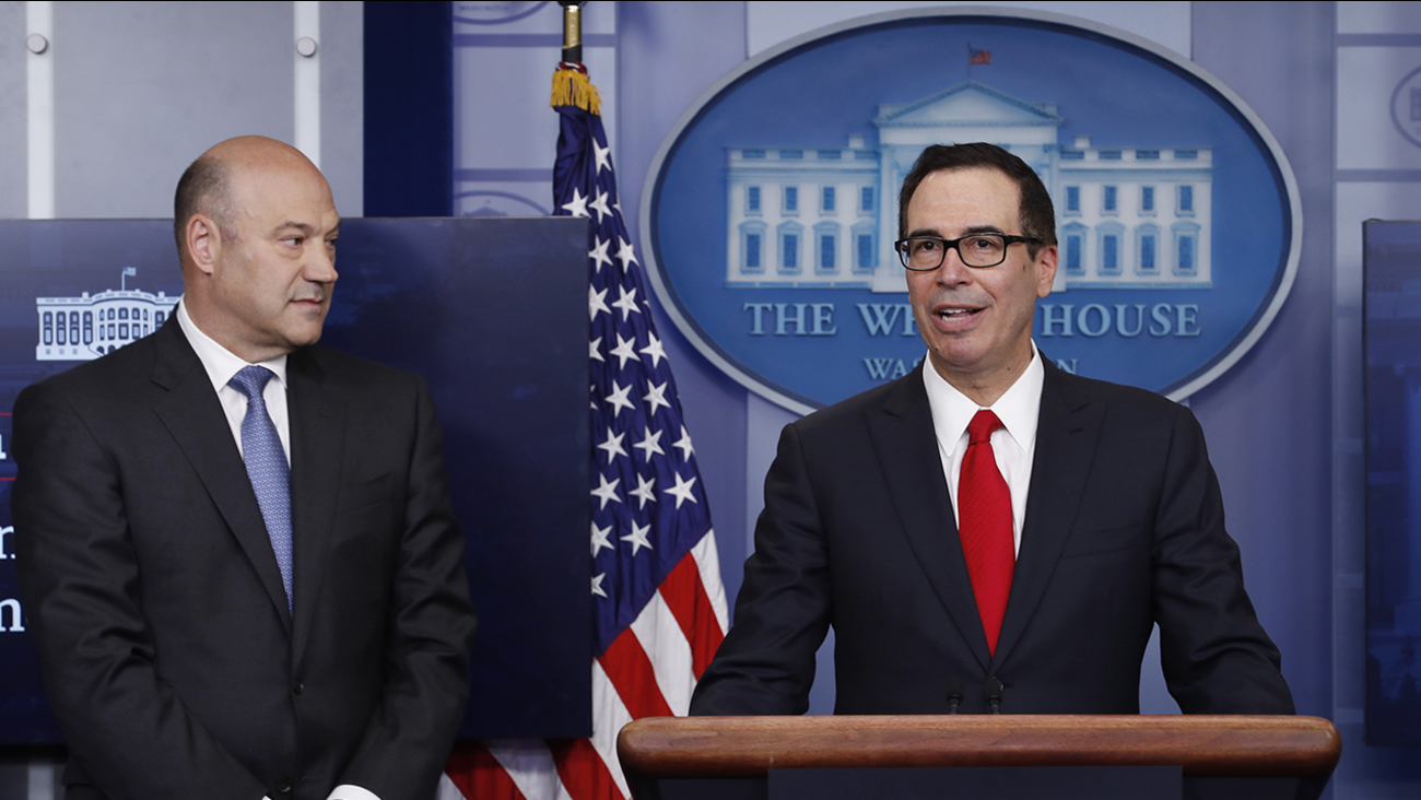 Treasury Secretary Steven Mnuchin, joined by National Economic Director Gary Cohn, speaks in the briefing room of the White House in Washington, Wednesday, April 26, 2017.