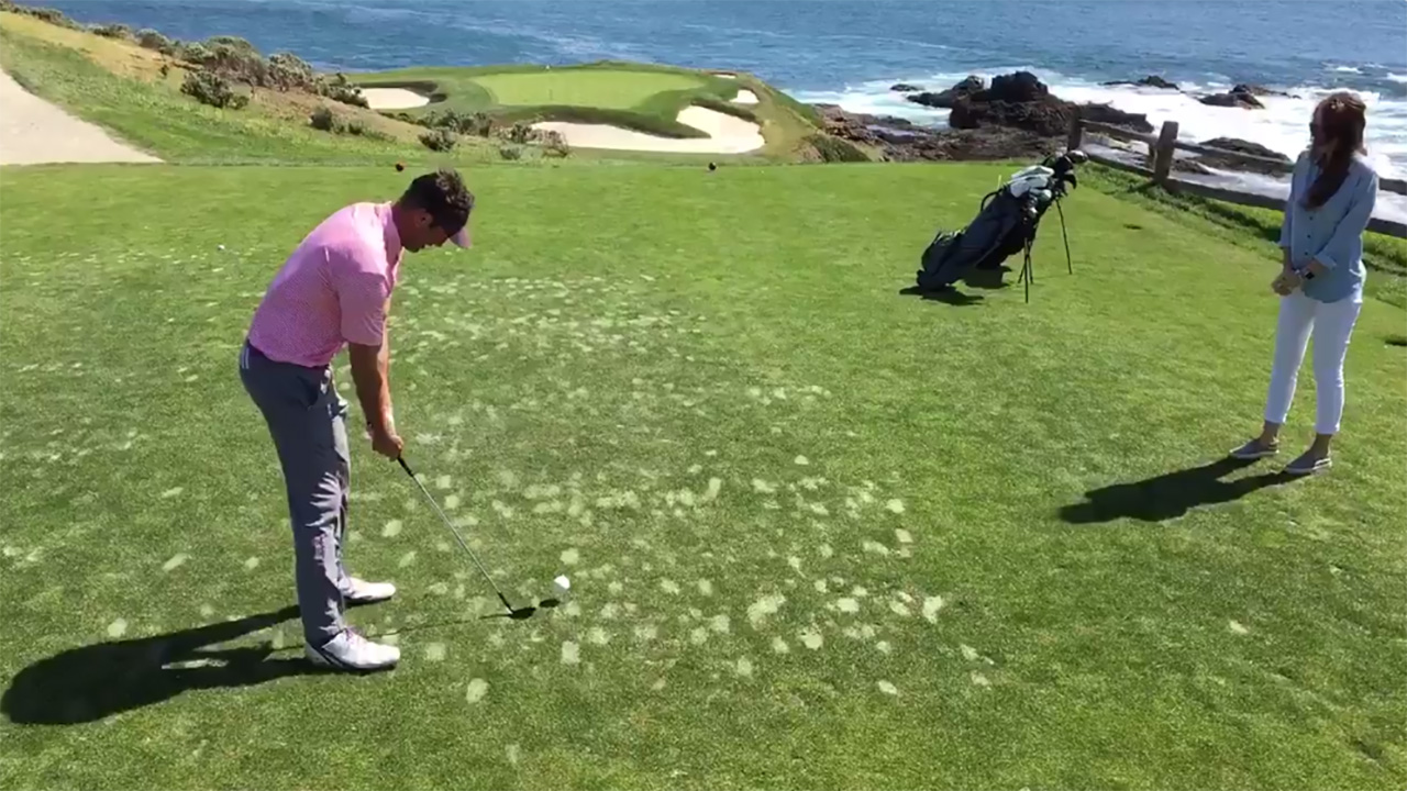 Image of a man hitting a golf ball to reveal the gender of his baby.