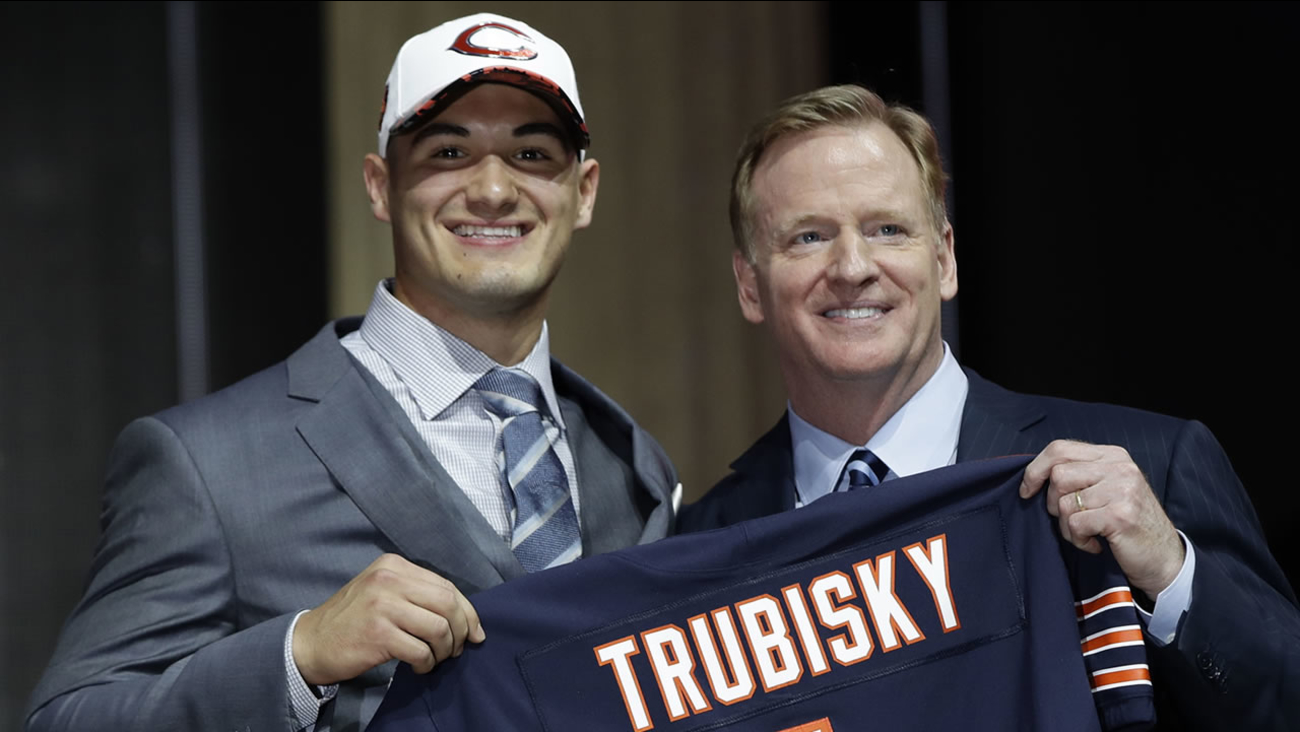 North Carolina's Mitch Trubisky, left, poses with NFL commissioner Roger Goodell after being selected by the Chicago Bears during the first round of the 2017 NFL football draft.