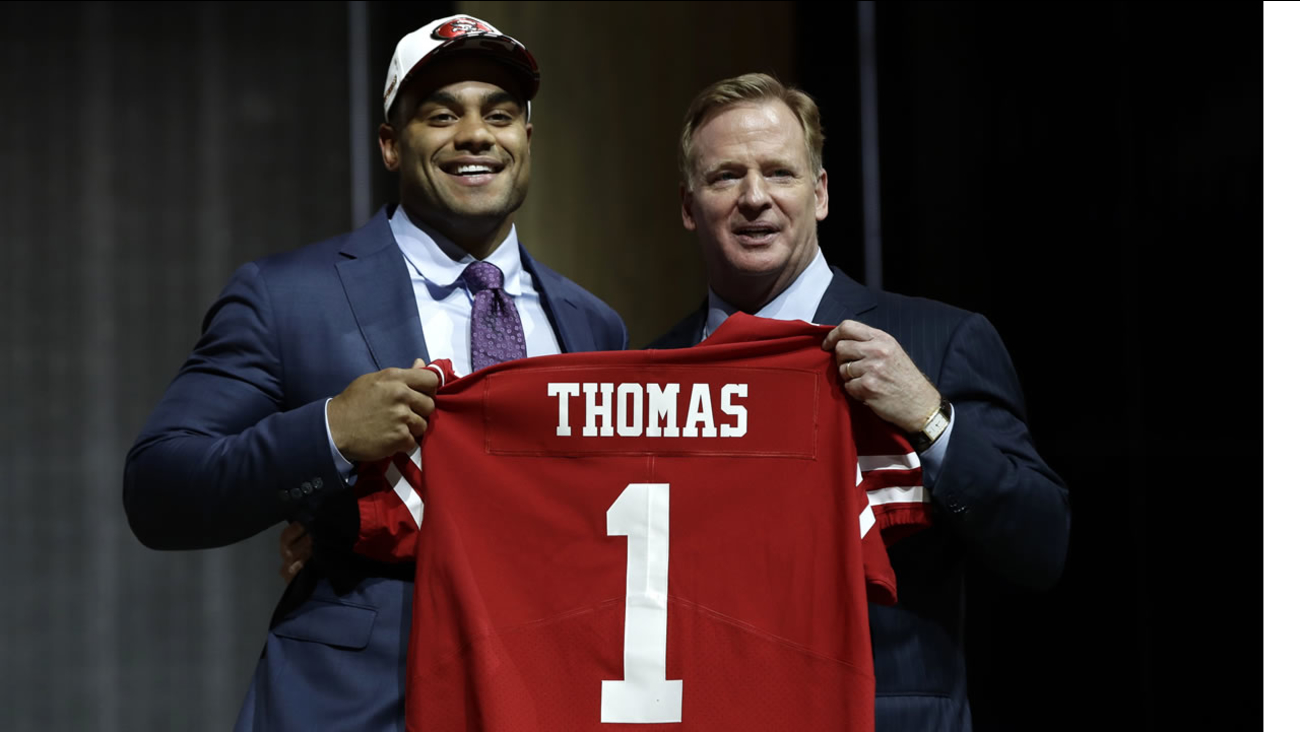 Stanford's Solomon Thomas poses with NFL commissioner Roger Goodell after being picked by the 49ers during the NFL Draft, Thursday, April 27, 2017 in Philadelphia.