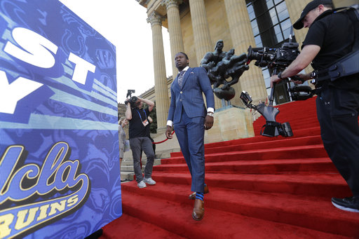 <div class='meta'><div class='origin-logo' data-origin='AP'></div><span class='caption-text' data-credit='AP'>UCLA's Takkarist McKinley arrives for the first round of the 2017 NFL football draft, Thursday, April 27, 2017, in Philadelphia. (AP Photo/Julio Cortez)</span></div>