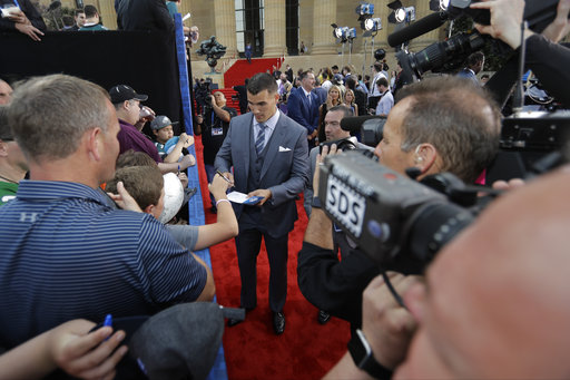 <div class='meta'><div class='origin-logo' data-origin='AP'></div><span class='caption-text' data-credit='AP'>North Carolina's Mitch Trubisky arrives for the first round of the 2017 NFL football draft, Thursday, April 27, 2017, in Philadelphia. (AP Photo/Julio Cortez)</span></div>