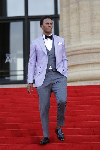 <div class='meta'><div class='origin-logo' data-origin='AP'></div><span class='caption-text' data-credit='AP'>Notre Dame's DeShone Kizer arrives for the first round of the 2017 NFL football draft, Thursday, April 27, 2017, in Philadelphia. (AP Photo/Julio Cortez)</span></div>