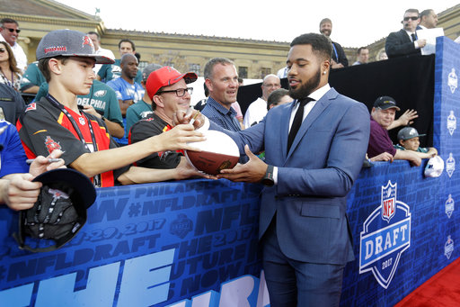 <div class='meta'><div class='origin-logo' data-origin='AP'></div><span class='caption-text' data-credit='AP'>Ohio State's Marshon Lattimore arrives for the first round of the 2017 NFL football draft, Thursday, April 27, 2017, in Philadelphia. (AP Photo/Julio Cortez)</span></div>