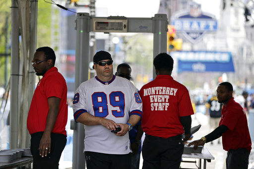 <div class='meta'><div class='origin-logo' data-origin='AP'></div><span class='caption-text' data-credit='AP'>A fan arrive through security ahead of the 2017 NFL football draft in Philadelphia, Thursday, April 27, 2017. (AP Photo/Matt Rourke)</span></div>