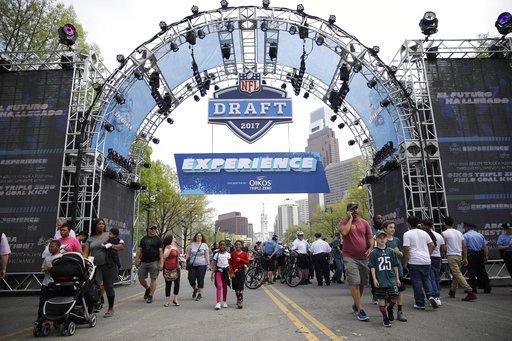 "<div class=""meta image-caption""><div class=""origin-logo origin-image ap""><span>AP</span></div><span class=""caption-text"">Fans arrive ahead of the 2017 NFL football draft in Philadelphia, Thursday, April 27, 2017. (AP Photo/Matt Rourke) (AP)</span></div>"