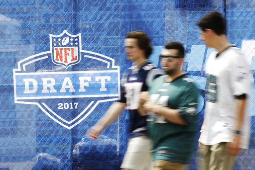 <div class='meta'><div class='origin-logo' data-origin='AP'></div><span class='caption-text' data-credit='AP'>Fans arrive ahead of the 2017 NFL football draft in Philadelphia, Thursday, April 27, 2017. (AP Photo/Matt Rourke)</span></div>