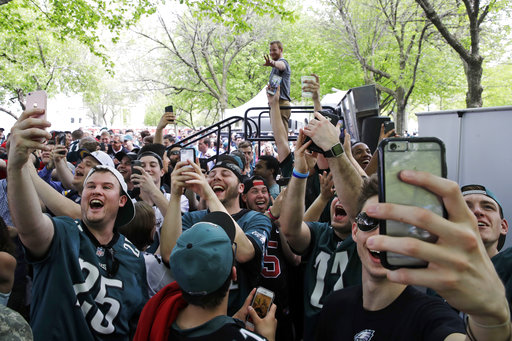 <div class='meta'><div class='origin-logo' data-origin='AP'></div><span class='caption-text' data-credit='AP'>Fans make selfies with Philadelphia Eagles' Carson Wentz, top rear, ahead of the 2017 NFL football draft in Philadelphia, Thursday, April 27, 2017. (AP Photo/Matt Rourke)</span></div>