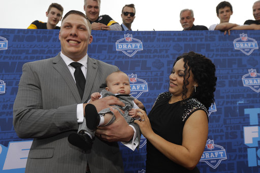 <div class='meta'><div class='origin-logo' data-origin='AP'></div><span class='caption-text' data-credit='AP'>Utah's Garett Bolles arrives with his son Kingston and wife Natalie for the first round of the 2017 NFL football draft (AP Photo/Julio Cortez)</span></div>