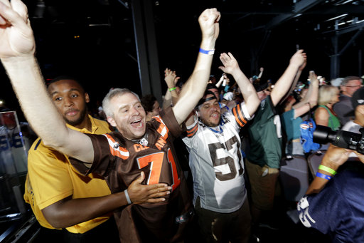 <div class='meta'><div class='origin-logo' data-origin='AP'></div><span class='caption-text' data-credit='AP'>Fans cheer after Texas A&M's Myles Garrett was selected with the number one overall pick by the Cleveland Browns (AP Photo/Julio Cortez)</span></div>