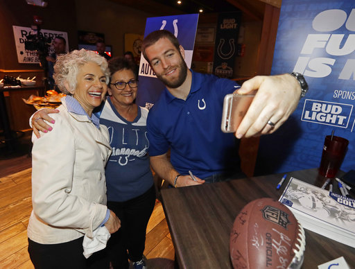 <div class='meta'><div class='origin-logo' data-origin='AP'></div><span class='caption-text' data-credit='AP'>Indianapolis Colts' Jack Doyle takes a photo with Fran Klene, left, and Sharon Smith during the NFL football team's draft party (AP Photo/Darron Cummings)</span></div>