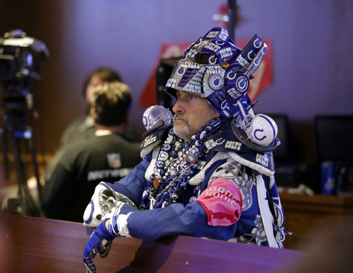 <div class='meta'><div class='origin-logo' data-origin='AP'></div><span class='caption-text' data-credit='AP'>Indianapolis Colts fan Michael Sisk waits for the Colts to draft as he watches during the NFL football team's draft party. (AP Photo/Darron Cummings)</span></div>