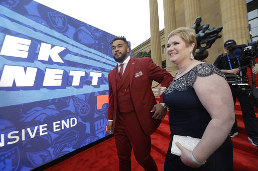 <div class='meta'><div class='origin-logo' data-origin='AP'></div><span class='caption-text' data-credit='AP'>Tennessee's Derek Barnett arrives for the first round of the 2017 NFL football draft, Thursday, April 27, 2017, in Philadelphia. (AP Photo/Julio Cortez)</span></div>