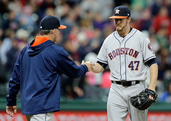 """<div class=""""meta image-caption""""><div class=""""origin-logo origin-image none""""><span>none</span></div><span class=""""caption-text"""">Houston Astros relief pitcher Chris Devenski, right, hands the ball off to manager A.J. Hinch during the seventh inning of the team's baseball game against the Cleveland Indians. (AP Photo/Tony Dejak)</span></div>"""