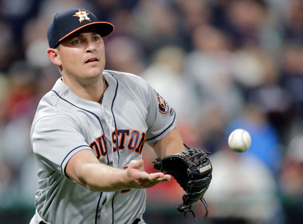 """<div class=""""meta image-caption""""><div class=""""origin-logo origin-image none""""><span>none</span></div><span class=""""caption-text"""">Houston Astros relief pitcher Will Harris tosses the ball to first bases to get Cleveland Indians' Lonnie Chisenhall out in the ninth inning of Thursday's game. (AP Photo/Tony Dejak)</span></div>"""