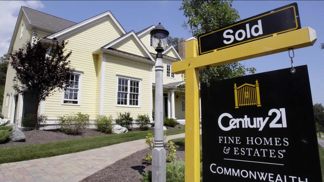 A sold sign is posted outside a newly constructed luxury home in Wellesley, Mass., Tuesday Aug. 25, 2009. (AP Photo/Charles Krupa)