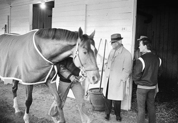 <div class='meta'><div class='origin-logo' data-origin='none'></div><span class='caption-text' data-credit='AP Photo'>Trainer Lucien Laurin (wearing hat), and jockey Ron Turcotte, right, watch as their horse, Secretariat, parades past them at stables of Churchill Downs in May 1973.</span></div>