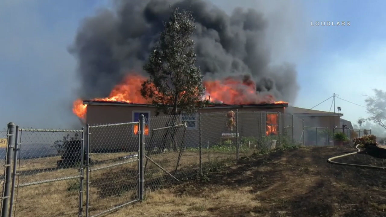 Fire engulfs a home in Riverside on Saturday, April 29, 2017.
