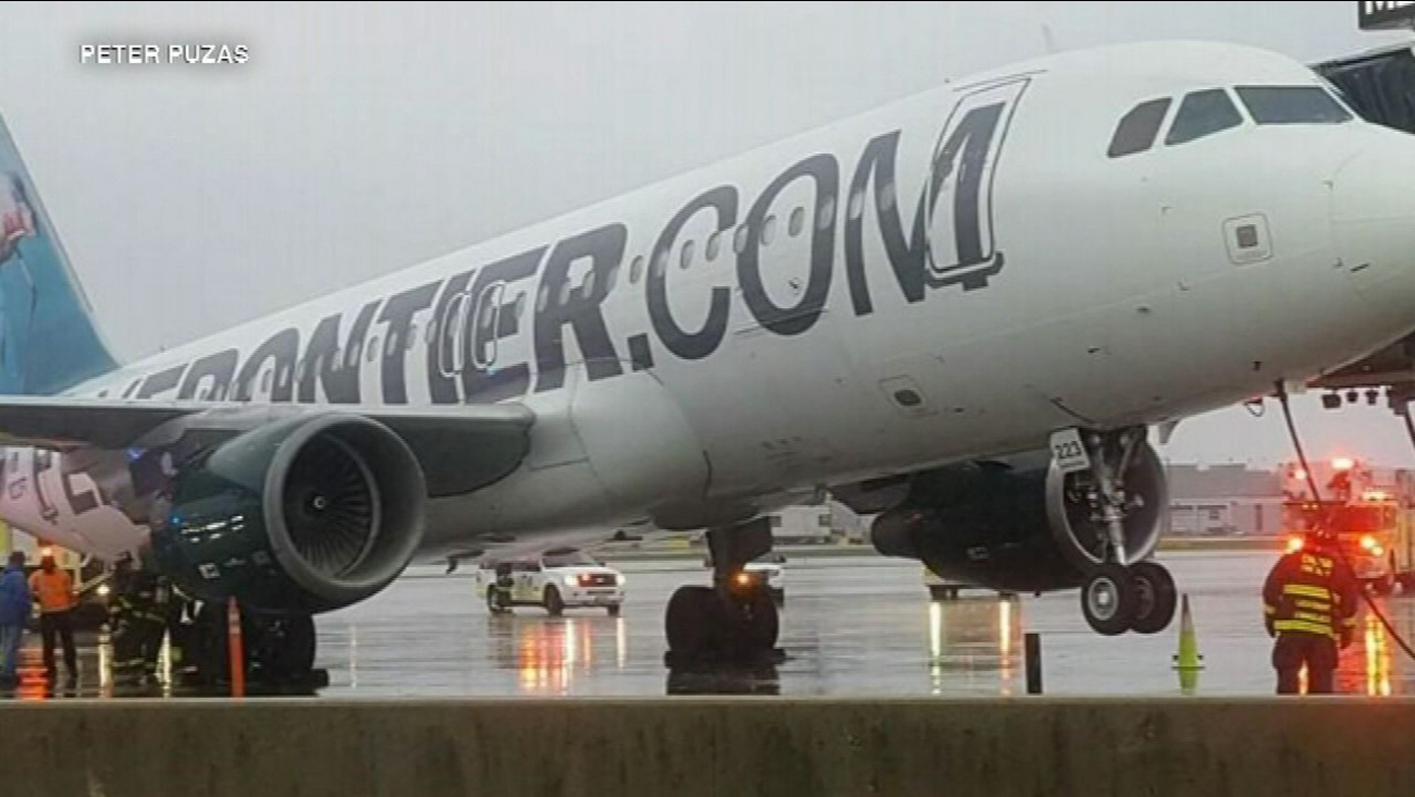 Plane tilts at O'Hare Airport