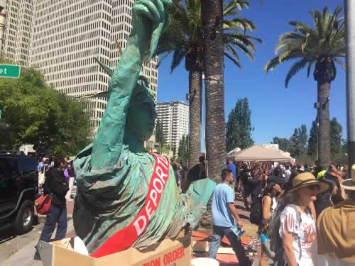 "<div class=""meta image-caption""><div class=""origin-logo origin-image none""><span>none</span></div><span class=""caption-text"">A May Day march took place at Justin Herman Plaza in San Francisco on Monday, May 1, 2017. (KGO-TV)</span></div>"