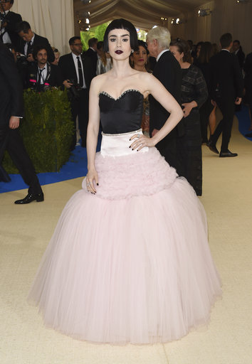 "<div class=""meta image-caption""><div class=""origin-logo origin-image ap""><span>AP</span></div><span class=""caption-text"">Lily Collins attends The Metropolitan Museum of Art's Costume Institute benefit gala celebrating the opening of the Rei Kawakubo/Comme des Garçons: Art of the In-Between exhibit. (Evan Agostini/Invision/AP)</span></div>"