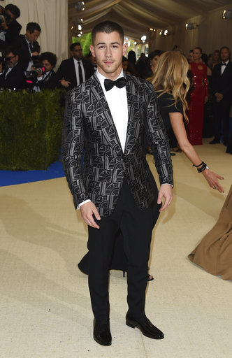 "<div class=""meta image-caption""><div class=""origin-logo origin-image ap""><span>AP</span></div><span class=""caption-text"">Nick Jonas attends The Metropolitan Museum of Art's Costume Institute benefit gala celebrating the opening of the Rei Kawakubo/Comme des Garçons: Art of the In-Between exhibit. (Evan Agostini/Invision/AP)</span></div>"