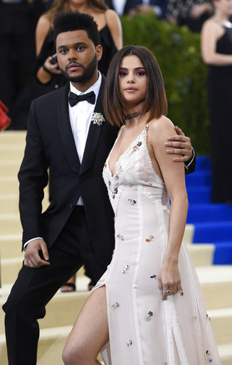 "<div class=""meta image-caption""><div class=""origin-logo origin-image ap""><span>AP</span></div><span class=""caption-text"">The Weeknd, left, and Selena Gomez attend The Met Gala celebrating the opening of the Rei Kawakubo/Comme des Garçons: Art of the In-Between exhibit (Evan Agostini/Invision/AP)</span></div>"