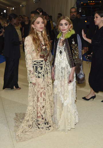 "<div class=""meta image-caption""><div class=""origin-logo origin-image ap""><span>AP</span></div><span class=""caption-text"">Mary-Kate Olsen and Ashley Olsen attend The Met Gala gala celebrating the opening of the Rei Kawakubo/Comme des Garçons: Art of the In-Between exhibit (Evan Agostini/Invision/AP)</span></div>"