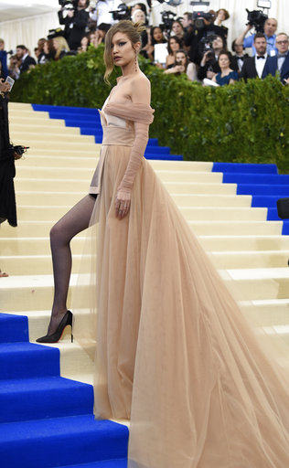 "<div class=""meta image-caption""><div class=""origin-logo origin-image ap""><span>AP</span></div><span class=""caption-text"">Gigi Hadid attends The Metropolitan Museum of Art's Costume Institute benefit gala celebrating the opening of the Rei Kawakubo/Comme des Garçons: Art of the In-Between exhibit. (Evan Agostini/Invision/AP)</span></div>"