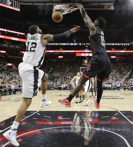 "<div class=""meta image-caption""><div class=""origin-logo origin-image ap""><span>AP</span></div><span class=""caption-text"">Houston Rockets center Clint Capela (15) score over San Antonio Spurs forward LaMarcus Aldridge (12), Monday, May 1, 2017, in San Antonio. (AP Photo/Eric Gay) (AP)</span></div>"
