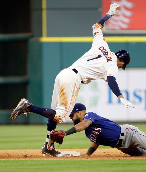 "<div class=""meta image-caption""><div class=""origin-logo origin-image none""><span>none</span></div><span class=""caption-text"">Houston Astros' Carlos Correa (1) avoids the tag of Texas Rangers' Rougned Odor after hitting a two-run double during the seventh inning of a baseball game, Monday, May 1, 2017. (AP Photo/David J. Phillip)</span></div>"
