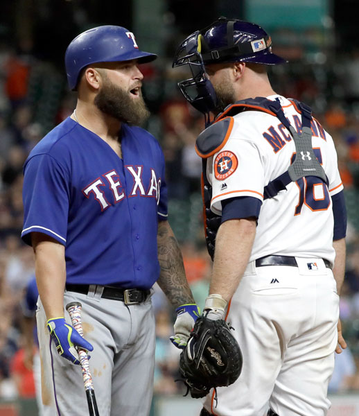 "<div class=""meta image-caption""><div class=""origin-logo origin-image none""><span>none</span></div><span class=""caption-text"">Texas Rangers' Mike Napoli, left, talks to Houston Astros catcher Brian McCann (16) after a close pitch thrown by starting pitcher Lance McCullers Jr. during the sixth inning. (AP Photo/David J. Phillip)</span></div>"