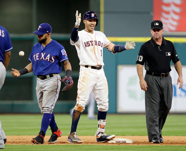 "<div class=""meta image-caption""><div class=""origin-logo origin-image none""><span>none</span></div><span class=""caption-text"">Houston Astros' Carlos Correa (1) celebrates after hitting a two-run double as Texas Rangers' Rougned Odor tosses the ball during the seventh inning of the game on Monday. (AP Photo/David J. Phillip)</span></div>"