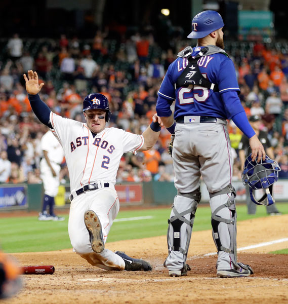 "<div class=""meta image-caption""><div class=""origin-logo origin-image none""><span>none</span></div><span class=""caption-text"">Houston Astros' Alex Bregman (2) slides safely across home plate as Texas Rangers catcher Jonathan Lucroy (25) waits for a throw during the seventh inning of a baseball game. (AP Photo/David J. Phillip)</span></div>"