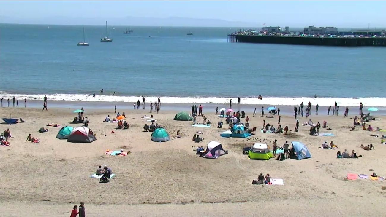 Beachgoers enjoy the hot weather in Santa Cruz, Calif. on Tuesday, May 2, 2017.