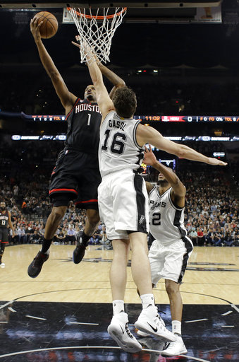 "<div class=""meta image-caption""><div class=""origin-logo origin-image ap""><span>AP</span></div><span class=""caption-text"">Houston Rockets forward Trevor Ariza (1) goes up for a shot as San Antonio Spurs' Pau Gasol (16) and LaMarcus Aldridge, right, defend during Game 2. (AP Photo/Eric Gay) (AP)</span></div>"
