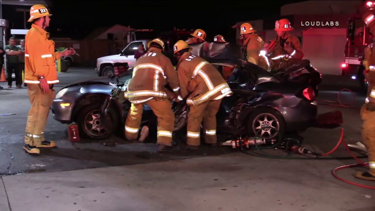 Firefighters worked to extricate the occupants of a wrecked sedan after a crash in Vernon on Thursday, April 4, 2017.