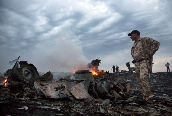 "<div class=""meta image-caption""><div class=""origin-logo origin-image ""><span></span></div><span class=""caption-text"">People walk amongst the debris, at the crash site of a passenger plane near the village of Grabovo, Ukraine, Thursday, July 17, 2014. (AP Photo/Dmitry Lovetsky)</span></div>"
