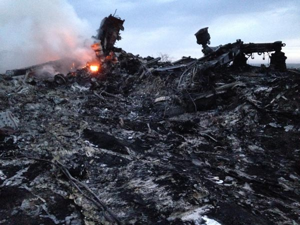 "<div class=""meta image-caption""><div class=""origin-logo origin-image ""><span></span></div><span class=""caption-text"">Smoke rises up at a crash site of a passenger plane, near the village of Grabovo, Ukraine, Thursday, July 17, 2014. (AP Photo/Dmitry Lovetsky)</span></div>"