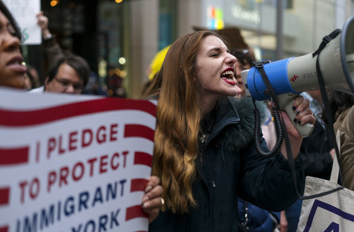 """<div class=""""meta image-caption""""><div class=""""origin-logo origin-image ap""""><span>AP</span></div><span class=""""caption-text"""">Protesters gather on 5th Avenue, near Trump Tower. President Donald Trump is slated to attend an event in New York on Thursday aboard the Intrepid on Thursday, May 4, 2017. (AP Photo/Craig Ruttle)</span></div>"""