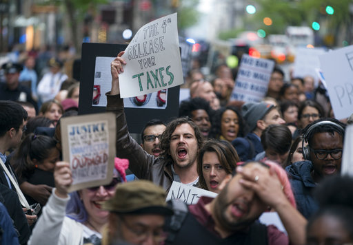 """<div class=""""meta image-caption""""><div class=""""origin-logo origin-image ap""""><span>AP</span></div><span class=""""caption-text"""">Protesters gather on 5th Avenue near Trump Tower. President Donald Trump is slated to attend an event in New York on Thursday aboard the Intrepid for a Commemorative Dinner. (AP Photo/Craig Ruttle)</span></div>"""