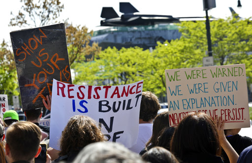 """<div class=""""meta image-caption""""><div class=""""origin-logo origin-image ap""""><span>AP</span></div><span class=""""caption-text"""">Protesters rally near the Intrepid Air and Sea Museum where President Trump is expected to visit Thursday May 4, 2017, in New York. (AP Photo/Bebeto Matthews)</span></div>"""